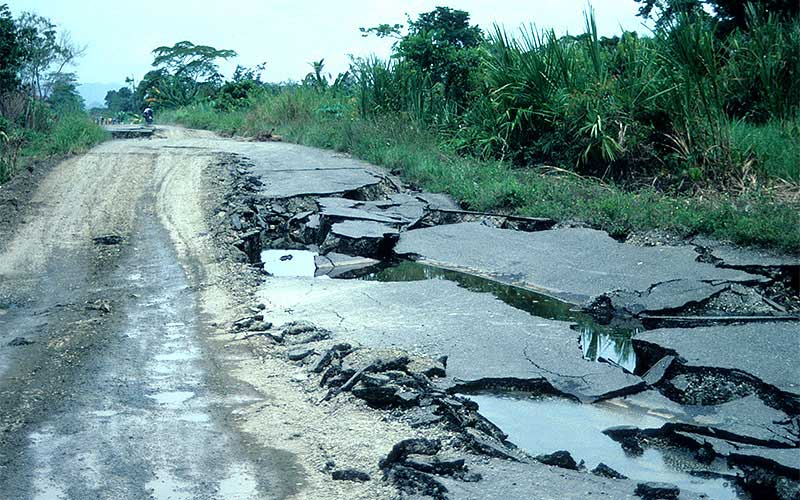 Costa Rica 1991 - The road next to the river had settled severely due to lateral spreading.  If you weren't in a 4 wheel drive, you couldn't get by.