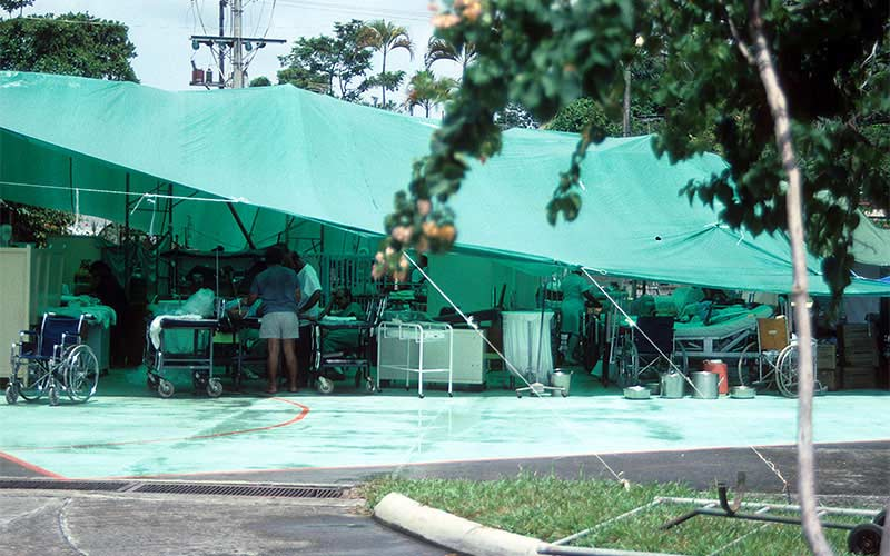 Costa Rica 1991 – The hospital in Puerto Limon was shut down and they set up operations in the parking lot under these tarps.  It was a shame that the non-structural damage forced them to leave the building, although the structure appeared to be fine.
