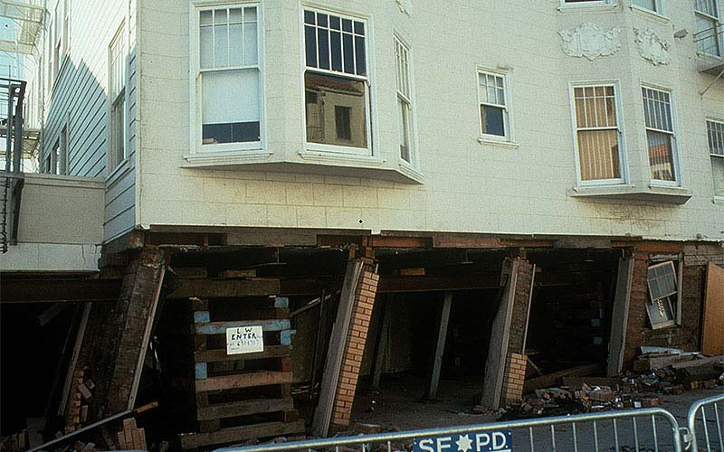 Loma Prieta 1989 - This was a pretty common scene in the Marina District, especially if the wood framed building was on a corner and not in the middle of the block.