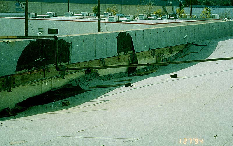 Northridge 1994 - This type of damage to the roof of a tilt-up building was fairly common - the roof framing pulled away from the exterior wall and was on the verge of collapsing.