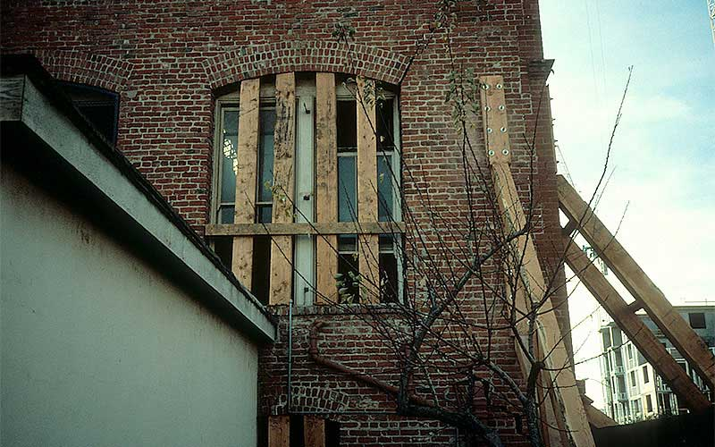 Loma Prieta 1989 - One of the many unreinforced masonry buildings that was severely damaged.  This view shows the temporary shoring that was installed to stabilize the structure until the options could be studied.